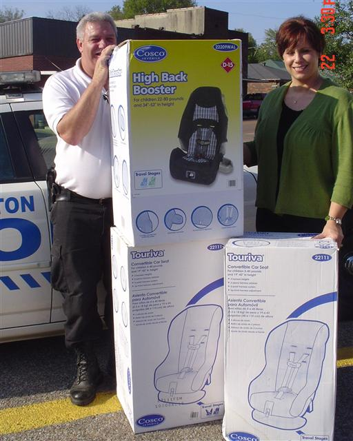 Chief Webb donates Protective Child Seats to our Local Carl Perkins Center Director Amanda Hopkins